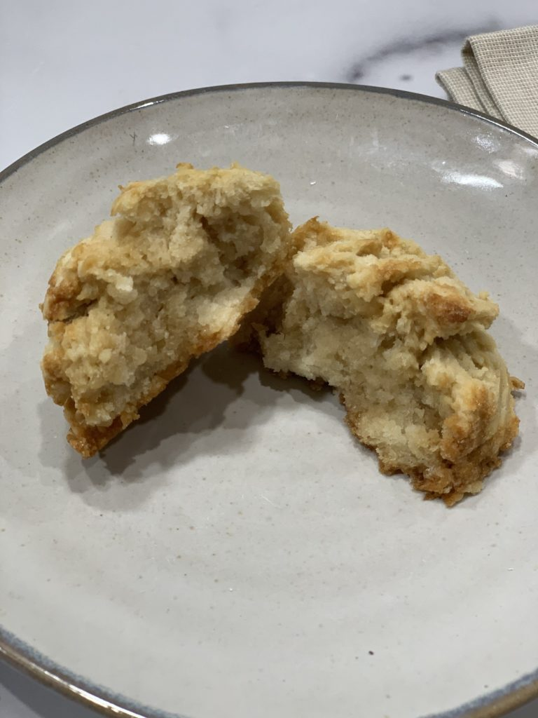 gluten free scone split in half and displayed on an earthenware plate