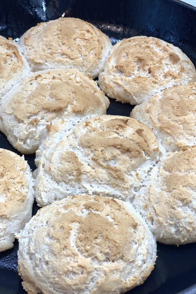 gluten free vegan slider buns in a cast iron skillet