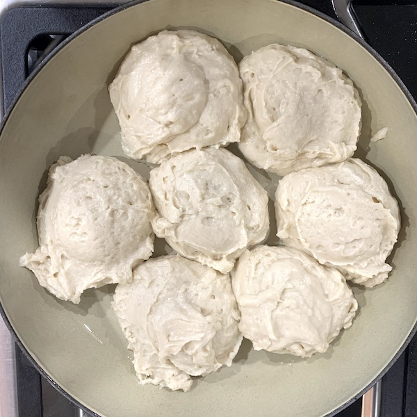 dairy free gluten free pull apart dinner rolls in a cast iron before the second proof
