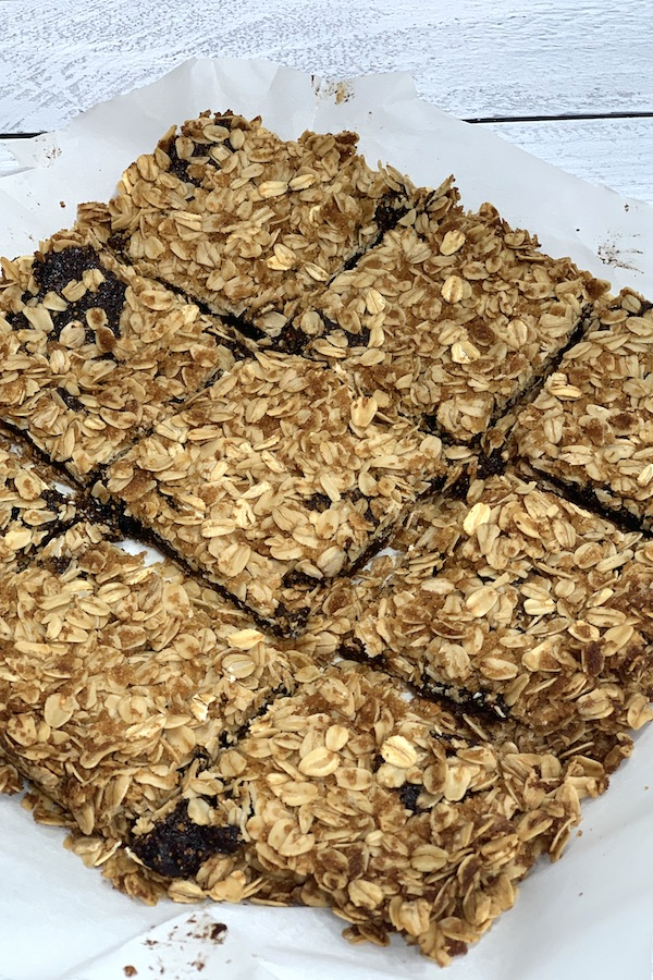 gluten free vegan homemade oatmeal fig bars in a square on parchment paper